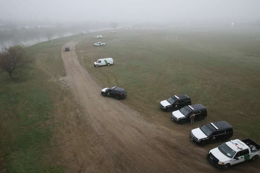 U.S. Border Patrol and Texas Department of Public Safety personnel guard the banks of the Rio Grande in Eagle Pass, Texas, Wednesday, Feb. 6, 2019. Law enforcement agencies from local to national level are on high alert after a caravan of around 1,800 Central American immigrants arrived at a shelter in Piedras Negras, Mexico across the Rio Grande from Eagle Pass on Monday.