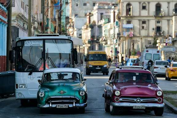 Old American cars are driven in a street of Havana, on December 12, 2019. - Cuba and the United States, former enemies of the Cold War, had a historic approach five years ago, but their relations deteriorated after the election of Donald Trump, who reinforced sanctions against the island. (Photo by YAMIL LAGE / AFP) (Photo by YAMIL LAGE/AFP via Getty Images)