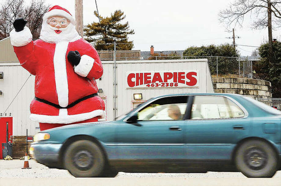 The large Santa at Cheapies Tire on East Broadway in Alton is repaired, painted and back on his feet. The fiberglass Santa has been in the area for decades and was damaged last December when someone backed into him.