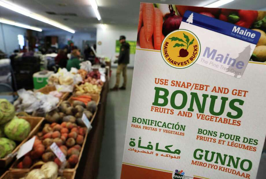 """A sign advertises a program that allows food stamp recipients to use benefits at a farmer's market in Maine. Changes meant to move """"able-bodied"""" adults off food stamps are not realistic. Photo: Associated Press File Photo / ONLINE_YES"""