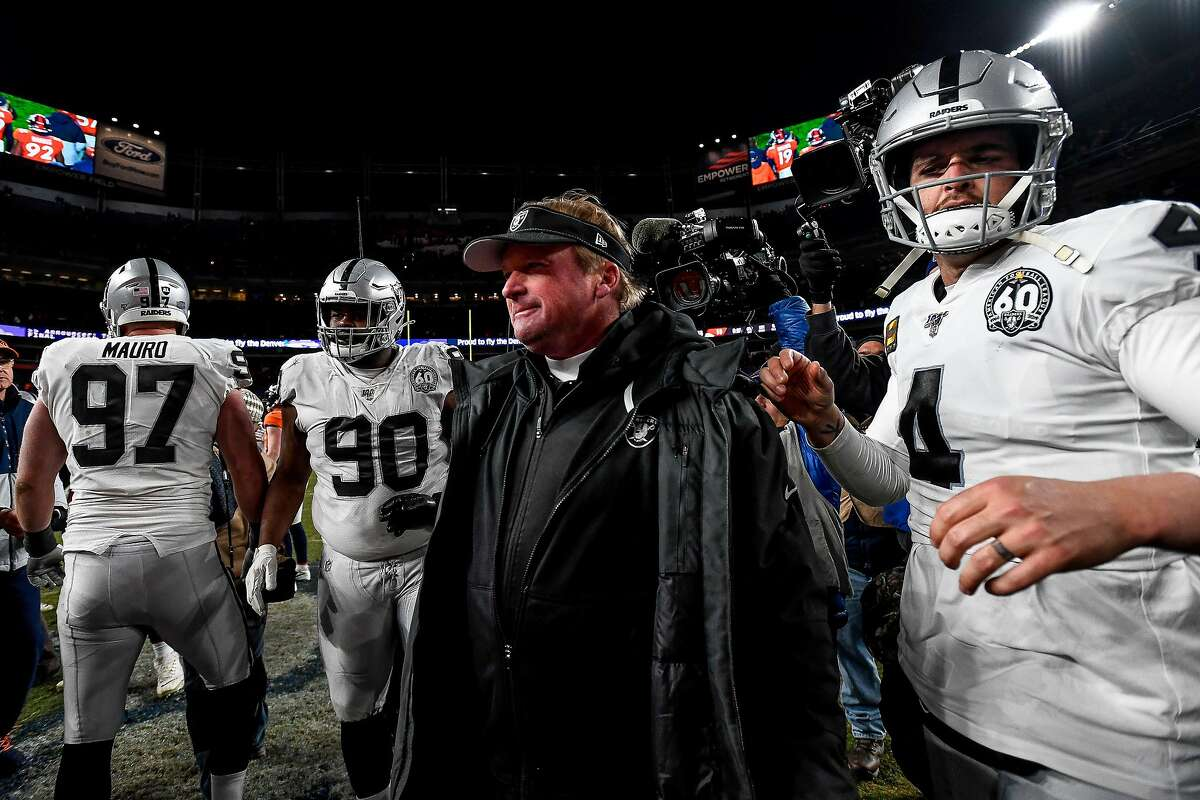 DENVER, CO - DECEMBER 29: Head coach Jon Gruden of the Oakland Raiders walks onto the field with Derek Carr #4 after a 16-15 loss to the Denver Broncos at Empower Field at Mile High on December 29, 2019 in Denver, Colorado. (Photo by Dustin Bradford/Getty Images)