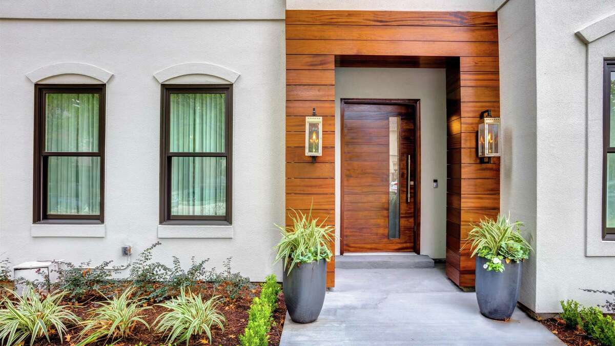 Easy upgrades to your home include improving your entrance. A new updated door creates a whole new welcome for your guests and improves curb appeal. The exterior of this home was redesigned by Missy Stewart of Missy Stewart Designs.