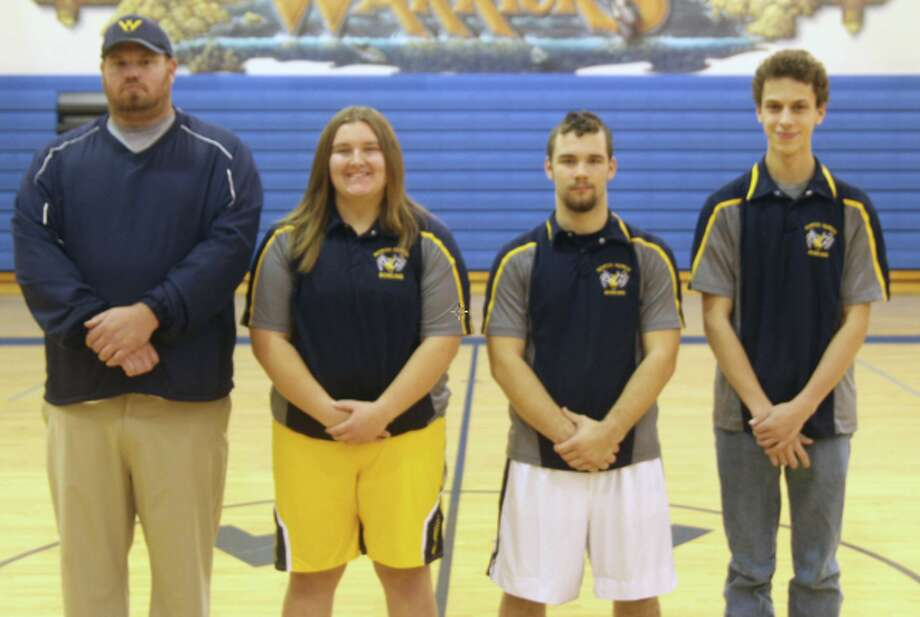 The 2019-2020 North Huron bowling team is, from left, head coach Jason Pierce, Patricia Pineau, Christian Brown and Kody Spicer. Photo: Eric Rutter/Huron Daily Tribune