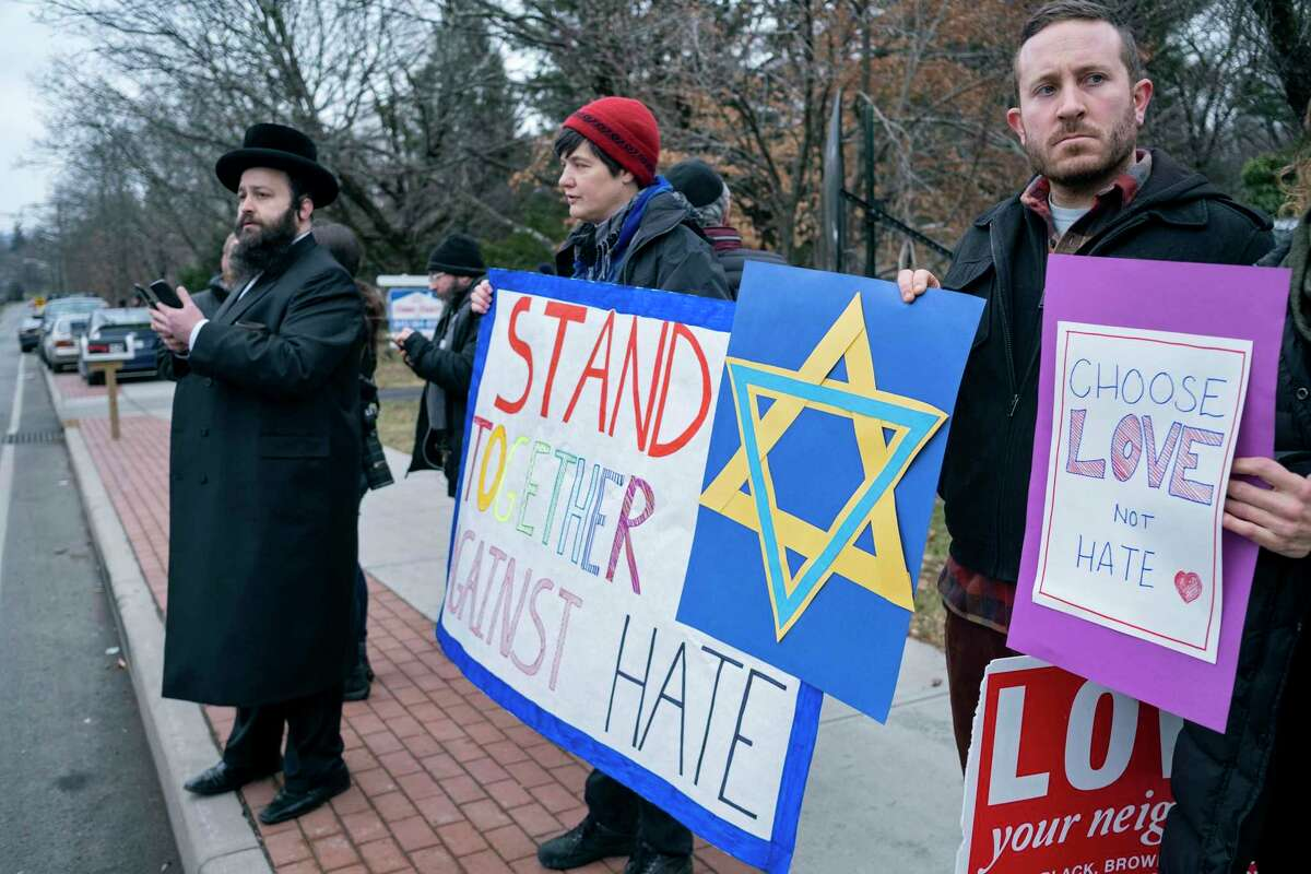 Neighbors gather to show their support of the community near a rabbi's residence in Monsey, N.Y., Sunday, Dec. 29, 2019, following a stabbing Saturday night during a Hanukkah celebration.