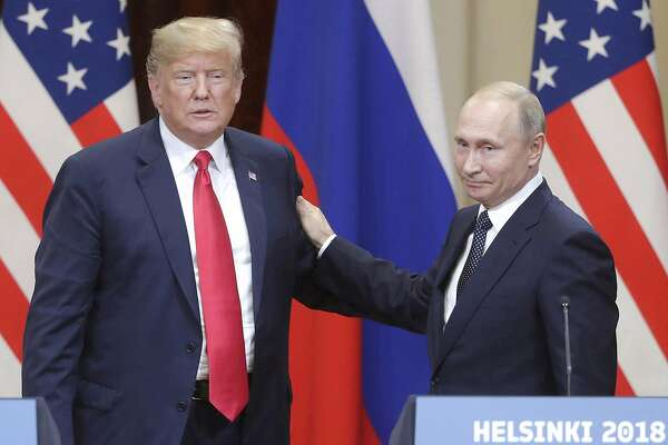 U.S. President Donald Trump, left, and Russia's President Vladimir Putin give a joint news conference following their meeting at the Presidential Palace in Helsinki, Finland, on July 16, 2018. (Mikhail Metzel/Tass/Abaca Press/TNS)
