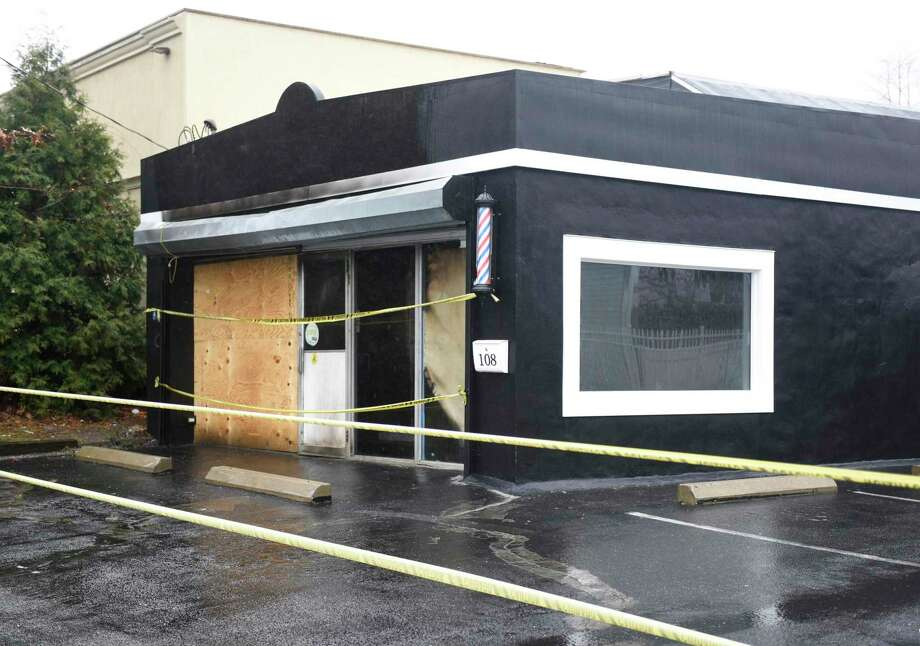 A building at 108 Connecticut Ave. in Norwalk, Conn. is damaged on Monday, Dec. 30, 2019 after a fire ripped through early Sunday morning. The structure, which was set to open up soon as a barber shop, sits across the street from the fire department and was put out quickly once firefighters gained entry. Photo: Tyler Sizemore / Hearst Connecticut Media / Greenwich Time