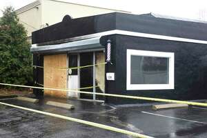 A building at 108 Connecticut Ave. in Norwalk, Conn. is damaged on Monday, Dec. 30, 2019 after a fire ripped through early Sunday morning. The structure, which was set to open up soon as a barber shop, sits across the street from the fire department and was put out quickly once firefighters gained entry.