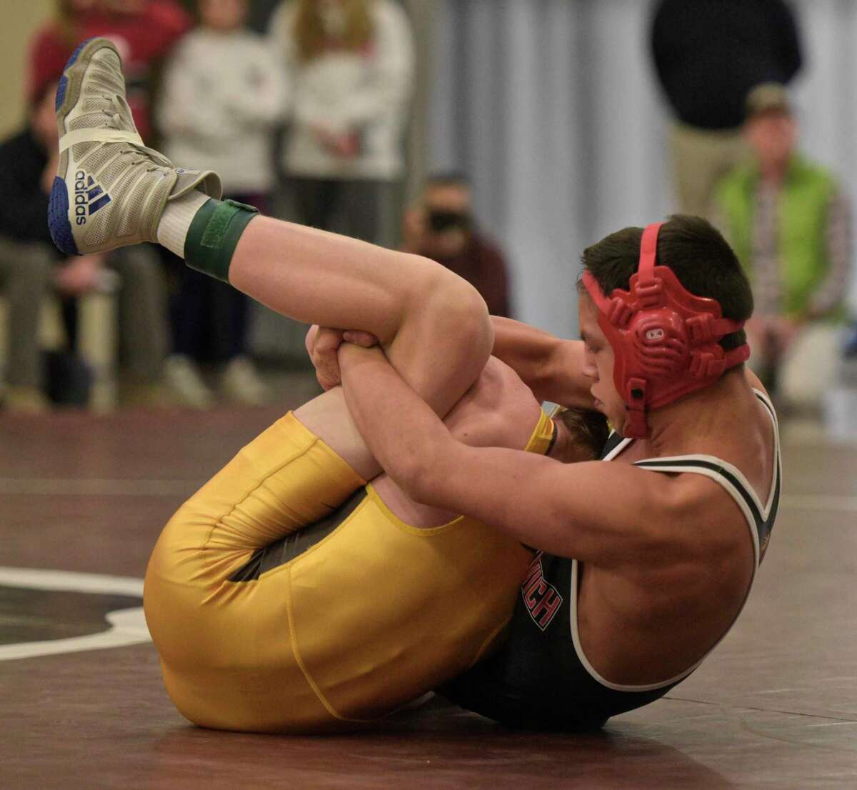 Greenwich junior Carlos DeWinter, right, won the 120-pound weight class title at the Gulford Invitational.