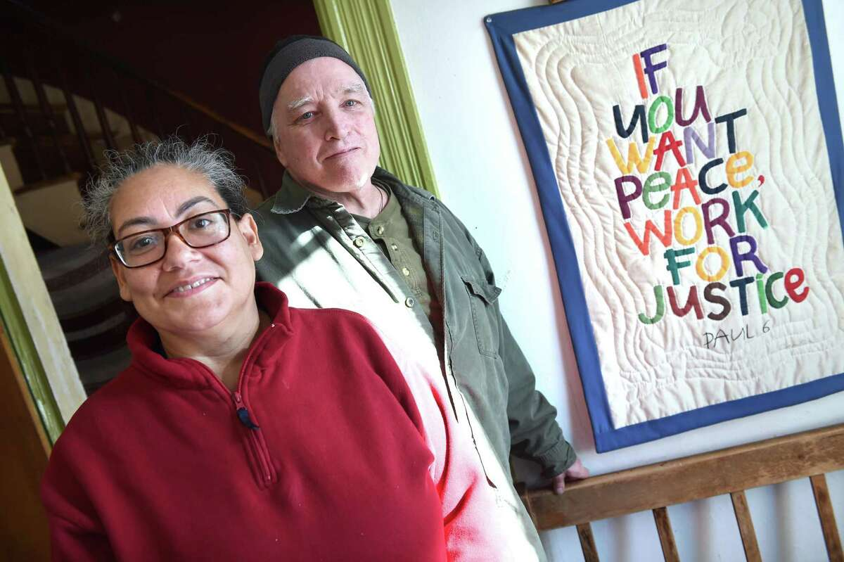 New Haven Register persons of the year Luz Catarineau and her husband, Mark Colville, photographed at the Amistad Catholic Worker House, which also is their home, on Rosette Street in New Haven on Dec. 23, 2019.