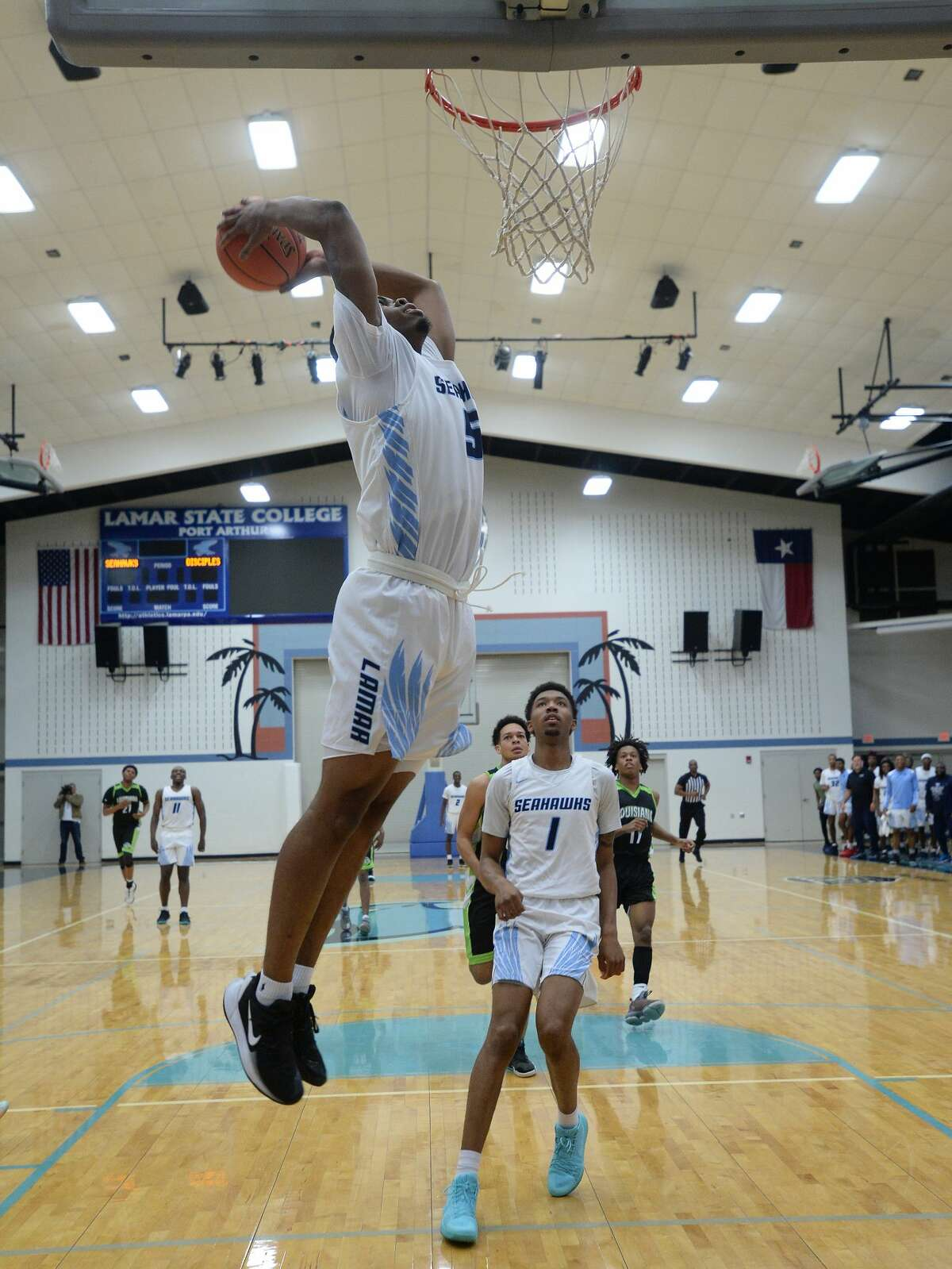 Lamar State College Port Arthur's Xavier Thompson goes in for a slam dunk against Louisiana Christian Prep during the Seahawk's New Year's Classic opening game Monday. Photo taken Monday, December 30, 2019 Kim Brent/The Enterprise