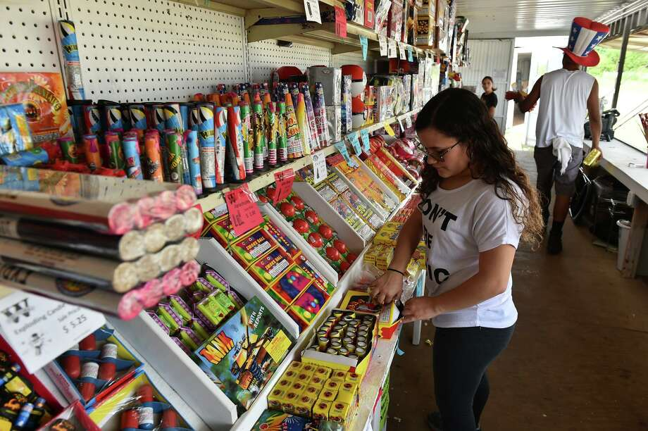 FILE PHOTO - Ilyonal Saunders stocks shelves with fireworks at Mr. W. Fireworks. Photo: Robin Jerstad /Robin Jerstad / ROBERT JERSTAD