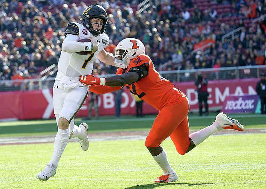 California quarterback Chase Garbers (7) scrabbles away from Illinois defensive lineman Ayo Shogbonyo (52) during Monday's Redbox Bowl game in Santa Clara, Calif. Photo: AP Photo
