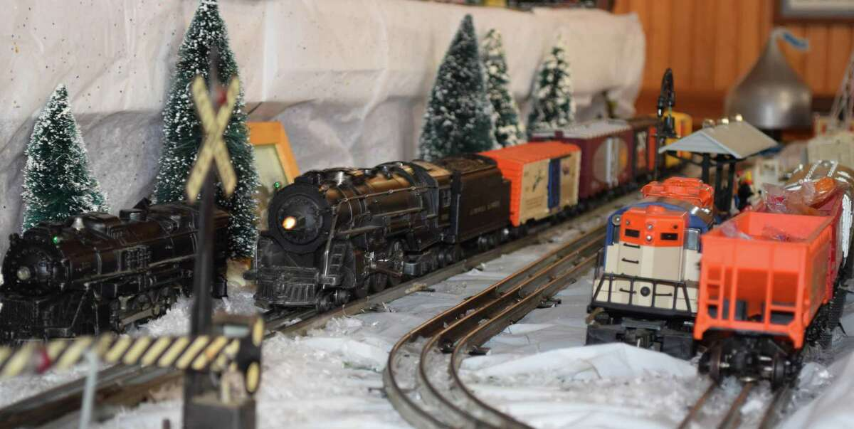A train makes its way around one of the tracks at the holiday display.