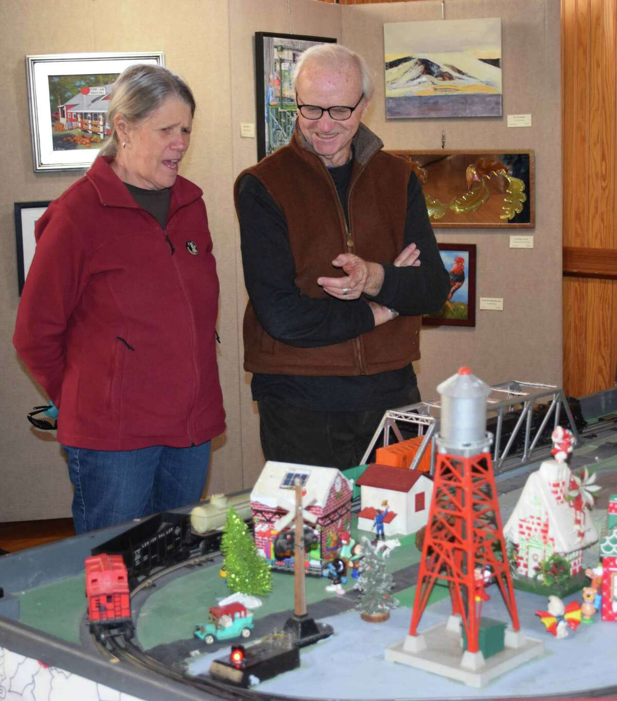 Bill and Barbara Quinnell admire one of the trains as it winds its way around a track.