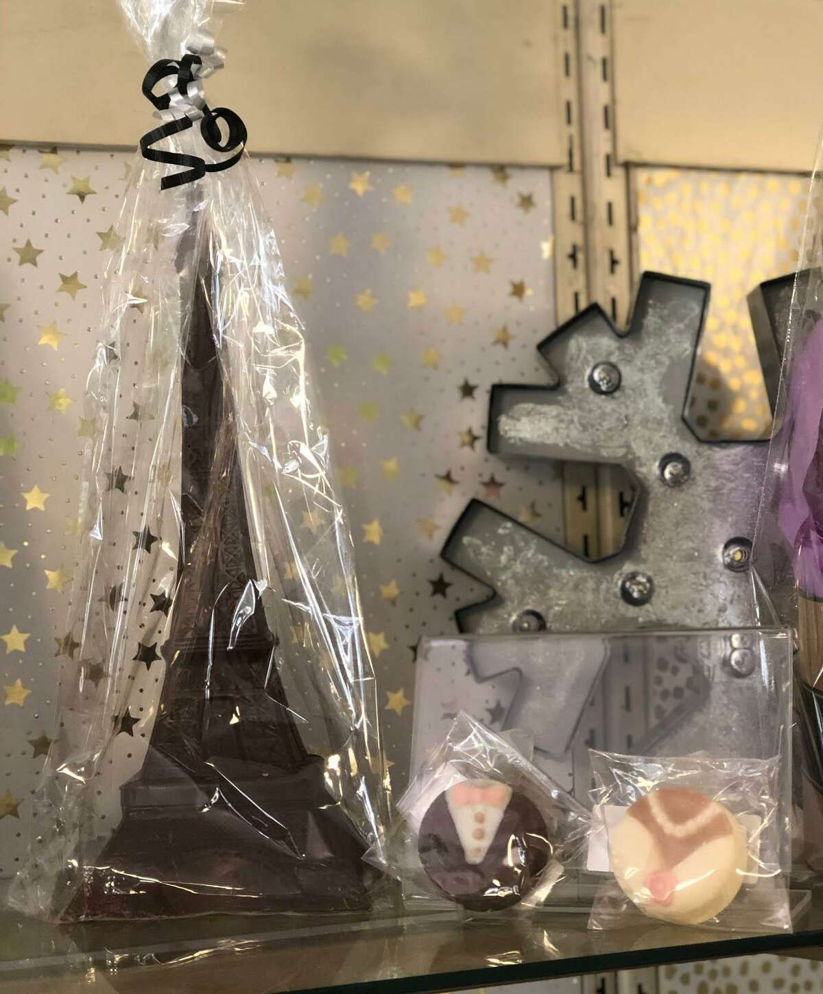 A chocolate Eiffel Tower and chocolate-covered cookies are among the wedding-themed products.