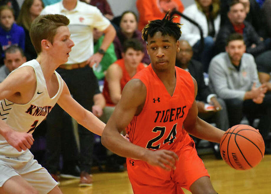 Edwardsville guard Jalil Roundtree attempts to drive around a Triad defender in the second quarter of Monday's 11th-place game at the Collinsville Tournament.