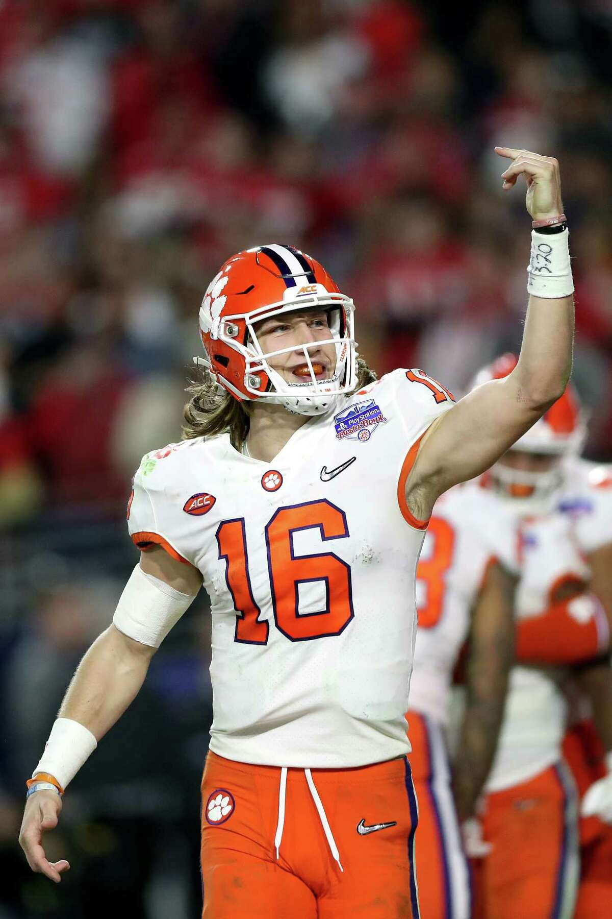 GLENDALE, ARIZONA - DECEMBER 28: Trevor Lawrence #16 of the Clemson Tigers celebrates his 34-yard touchdown pass to Travis Etienne (not pictured) against the Ohio State Buckeyes in the second half during the College Football Playoff Semifinal at the PlayStation Fiesta Bowl at State Farm Stadium on December 28, 2019 in Glendale, Arizona. (Photo by Matthew Stockman/Getty Images)