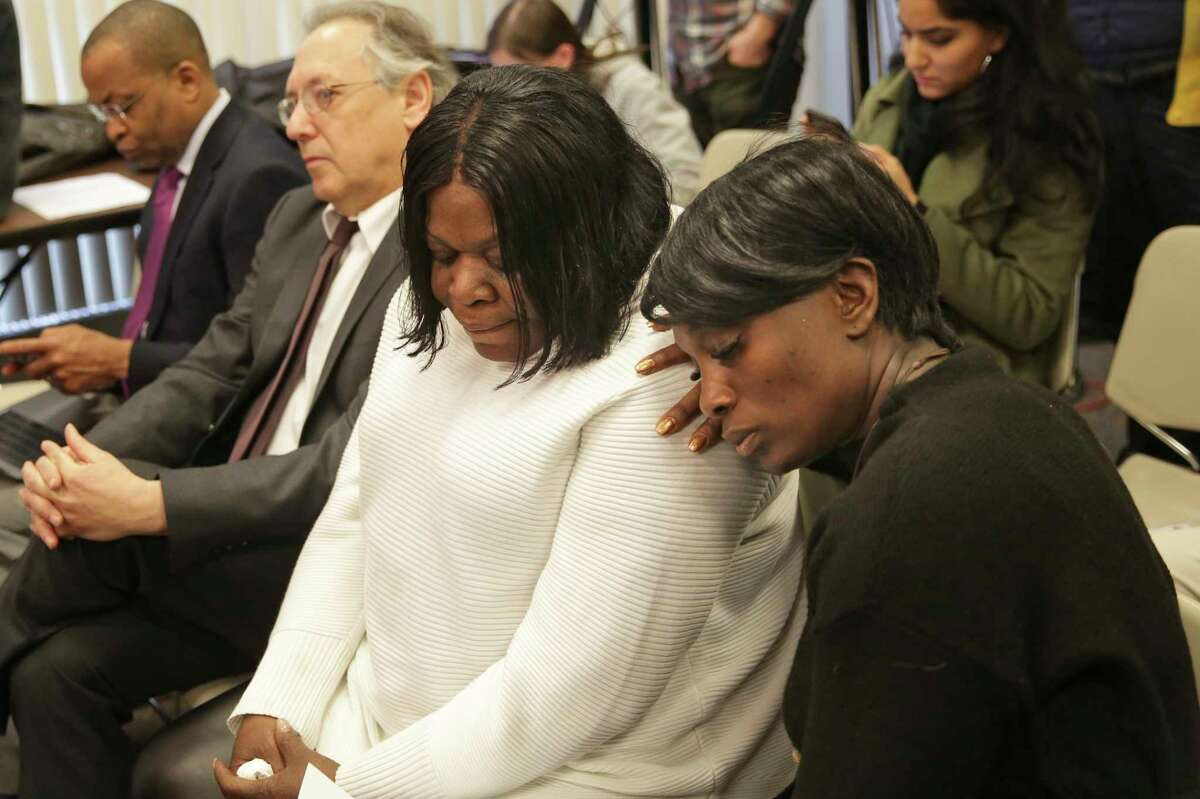 Kim Thomas, center, mother of Grafton Thomas, the man accused of stabbing multiple people at a Hanukkah celebration, is comforted by Rev. Wendy Paige at a news conference in New City, N.Y., Monday, Dec. 30, 2019. (AP Photo/Seth Wenig)
