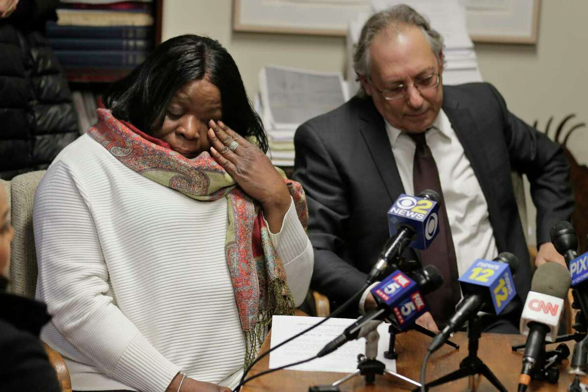 Kim Thomas, left, mother of Grafton Thomas, the man accused of stabbing five people at a Hanukkah celebration, reacts during a news conference as attorney Michael Sussman speaks in Goshen, N.Y., Monday, Dec. 30, 2019. (AP Photo/Seth Wenig)