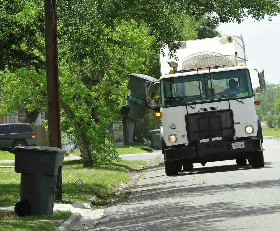 Garbage pickup in several area towns will be affected by the New Year's Day holiday. Photo: Dave Ryan / Dave Ryan/The Enterprise