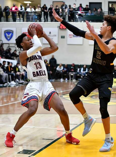 Dublin's Anthony Roy looks for a way around the defensive pressure of Chase Catchings of Rancho Christian-Temecula in the first round of the Classic at Damien Tournament.