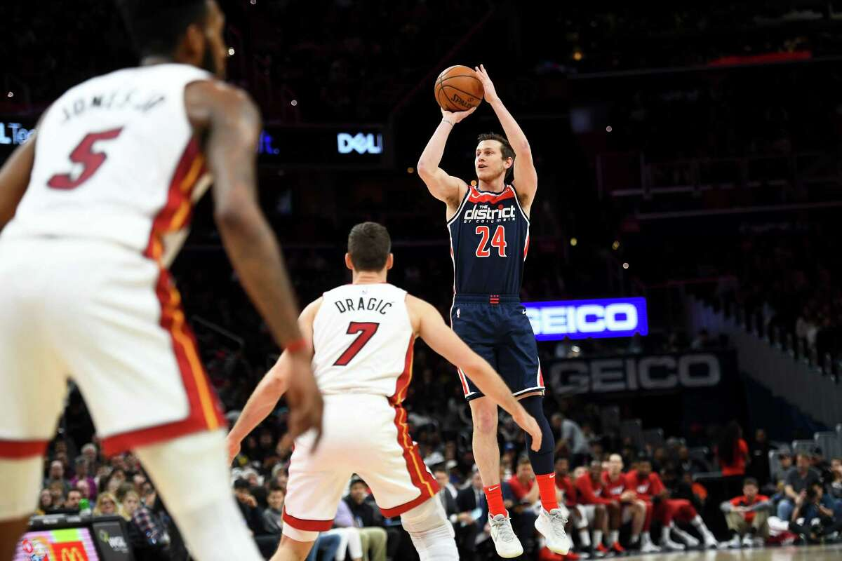 Washington Wizards guard Garrison Mathews scored 20 of his career-high 28 points in the second quarter, and the Wizards shocked the Heat, 123-105.