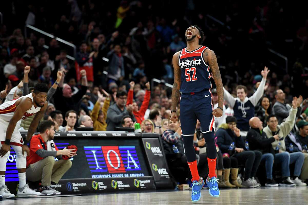 Washington Wizards guard Jordan McRae screams after hitting a three-pointer late in the second half against the Miami Heat on Monday, Dec. 30, 2019. He scored 29 points to help the Washington Wizards beat the Miami Heat 123-105.