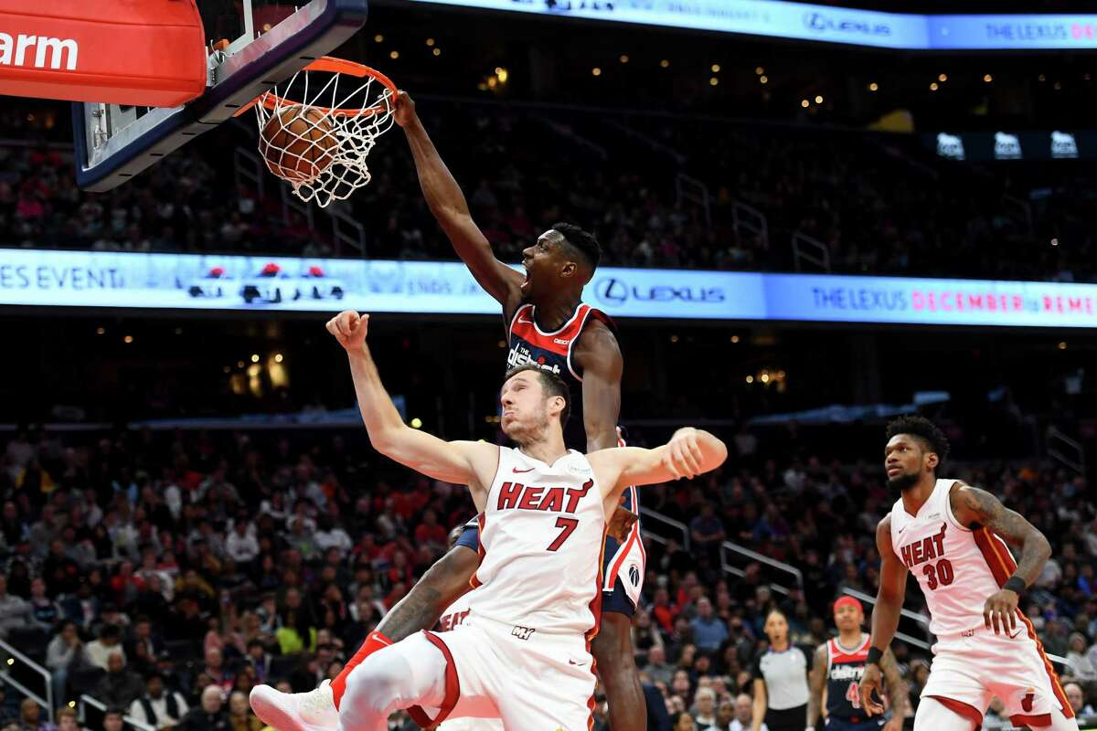 Washington Wizards center Ian Mahinmi dunks on Miami Heat guard Goran Dragic on Monday, Dec. 30, 2019.