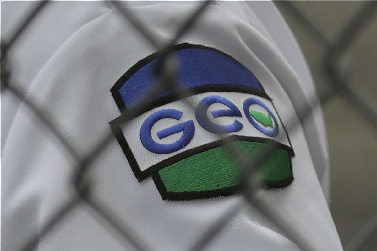 A patch is shown on the uniform of a guard with the GEO Group, Inc., during a media tour of the U.S. Immigration and Customs Enforcement detention center, Monday, Dec. 16, 2019, in Tacoma, Wash. The GEO Group is the private company that operates the center for the U.S. Government. (AP Photo/Ted S. Warren)