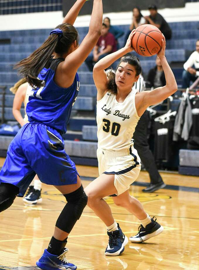 Aly Benavides scored a game-high 12 points Monday for Alexander in a 69-42 win at home over Joselin Rodriguez and Cigarroa. Rodriguez led the Lady Toros with 10 points and seven rebounds. Photo: Danny Zaragoza /Laredo Morning Times / Laredo Morning Times
