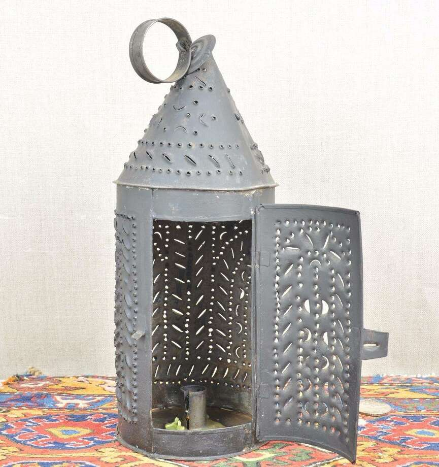 A tin-punched lantern like the one used by Paul Revere in colonial America.