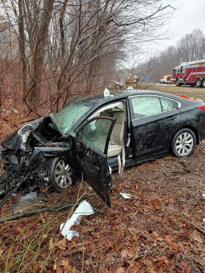 Shelton fire and emergency crews responded to a two-vehicle accident Monday, Dec. 30, on Route 8 southbound between exits 12 and 13 causing major traffic problems all morning. Photo: Shelton Fire Department / Contributed Photo / Connecticut Post