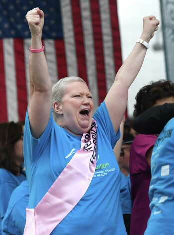 Norwalk's Kathleen Weberg, who just finished treatment for stage three breast cancer, celebrates at the start of the 23rd annual Hope in Motion Walk & Run at Columbus Park in Stamford, Conn. Sunday, June 2, 2019. More than 3,000 participants walked and ran in the 5K, 10K, and fun walk to benefit Stamford Health's Bennett Cancer Center. About $600,000 was raised to sustain the integrative medicine program, which is free of charge to patients, as well as the clinical trials program, art therapy program, and grateful patient program. Photo: Tyler Sizemore / Tyler Sizemore / Hearst Connecticut Media