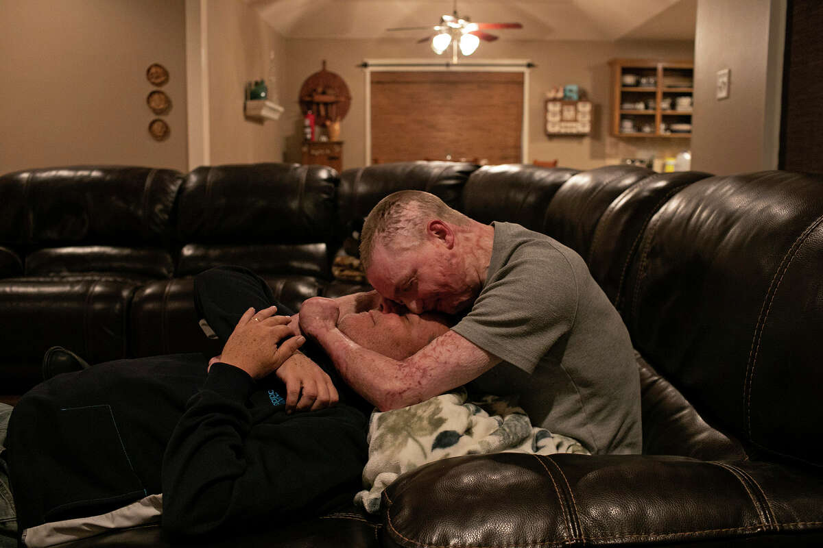 """Zachary Sutterfield spends time with his father, Karl Sutterfield, at their home in San Angelo on Dec. 29, 2019. The family is verbally and physically expressive of their love for each other every day, saying """"I love you,"""" and embracing, often."""