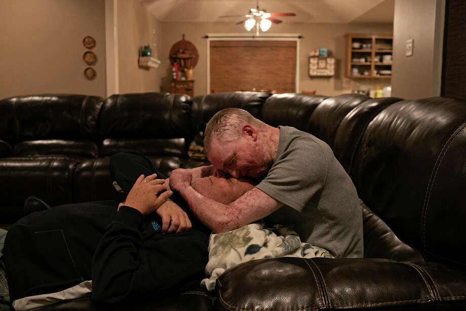"Zachary Sutterfield spends time with his father, Karl Sutterfield, at their home in San Angelo on Dec. 29, 2019. The family is verbally and physically expressive of their love for each other every day, saying ""I love you,"" and embracing, often. Photo: Lisa Krantz"