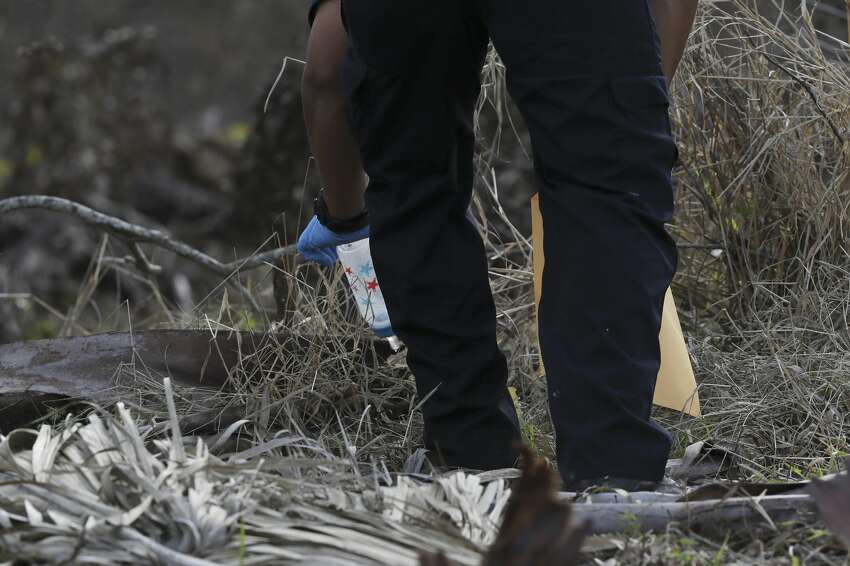 A San Antonio Police crime scene investigator collects a baby bottle from an area along Leon Creek by Rodriguez County Park after finding evidence pertaining to missing eight-month-old King Jay Davila, Sunday, Jan. 6, 2019. The child went missing after being abducted from a nearby convenient store on Friday. A group of family and friends searching the area found a baby bottle that the mother of the child said belong to Davila.