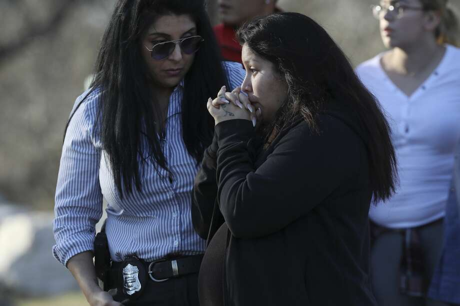 Jasmine Gonzales, mother of missing eight-month-old King Jay Davila, talks with a San Antonio Police investigator by an area along Leon Creek by Rodriguez County Park, Sunday, Jan. 6, 2018. The child went missing after being abducted from a nearby convenient store on Friday. A group of family and friends searching the area found a baby bottle that she said belong to her son. Soon after taking with the investigator, Gonzales left the scene. Photo: JERRY LARA/Staff Photographer