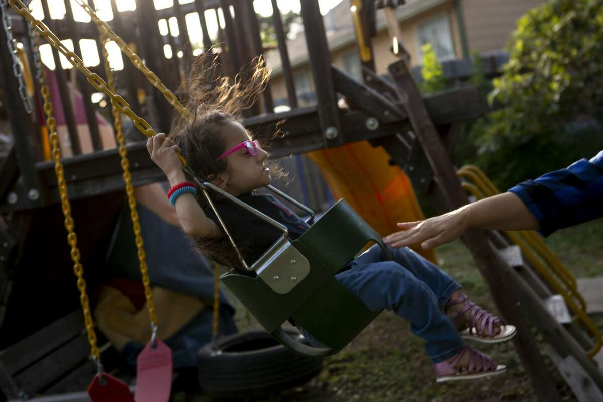 Sammi Haney, 9, is pushed by her mother Priscilla Haney on the swing set in her backyard in San Antonio, Texas, Sept. 26, 2019. Sammi plays a supporting role in the new Netflix series Ã?'Raising Dion,Ã?