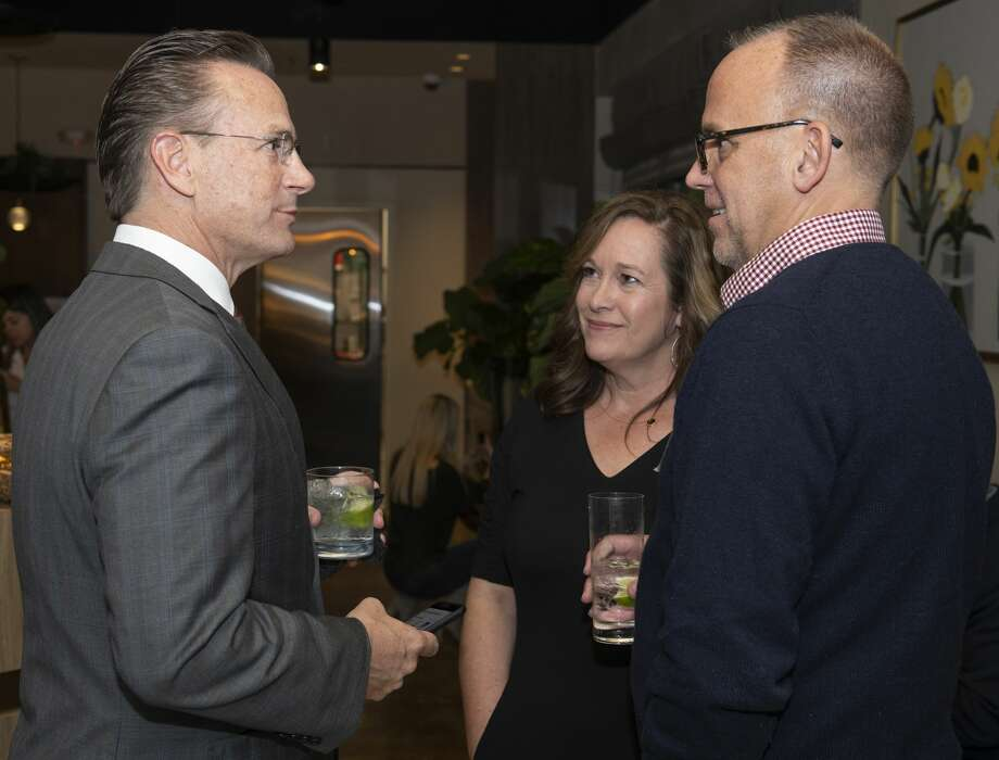Patrick Payton, left, and his wife, Cindy, talk with Mike Goeke at an election night party Nov. 5 at Butter. Payton defeated incumbent Jerry Morales and Jenny Cudd in the mayor's race. He assumes office later this month. Photo: Tim Fischer/Midland Reporter-Telegram