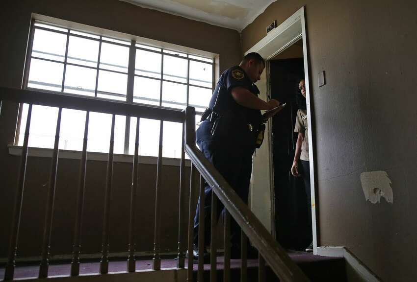 Bexar County Deputy Constable Edward Prado of Precinct 4 delivers an eviction citation to a resident at Spanish Oaks Apartments on Wednesday, Nov. 6, 2019.