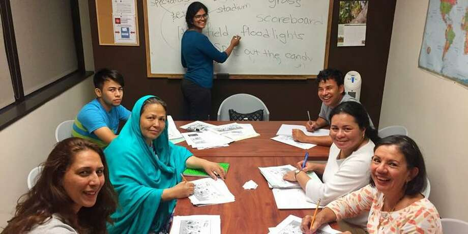 Women in a Memorial Assistance Ministries English as a Second Language class work on learning English. Photo: Courtesy By MAM