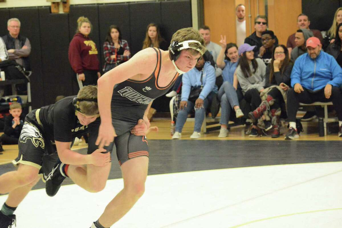 Stefan Sigurdsson (shown last season) and the Ridgefield wrestling team won a dual meet and then finished eighth at a holiday tournament.