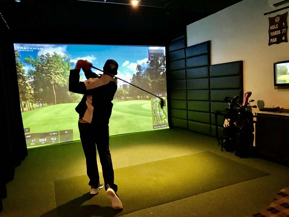 Kevin Kost, of Charleston, S.C. hits a shot on the Trackman golf simulator at The Bunker.