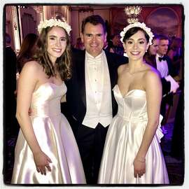 Christian Huebner with his twin debutante daughters, Frances (left) and Katharine Huebner at the Cotillion Debutante Ball. Dec. 21, 2019.