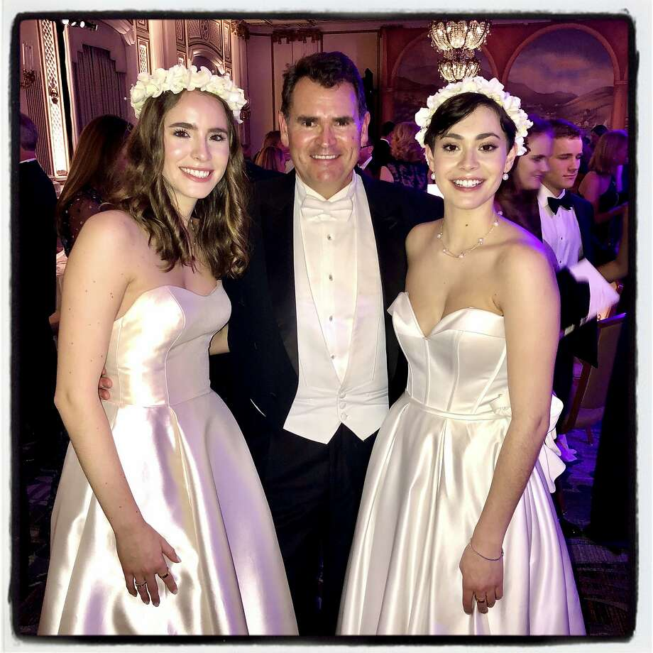Christian Huebner with his twin debutante daughters, Frances (left) and Katharine Huebner, at the Cotillion Debutante Ball. Dec. 21, 2019. Photo: Catherine Bigelow / Special To The Chronicle