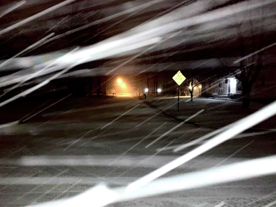 Images of Monday night's snowfall in Midland. Photo: Fred Kelly/fred.kelly@mdn.net