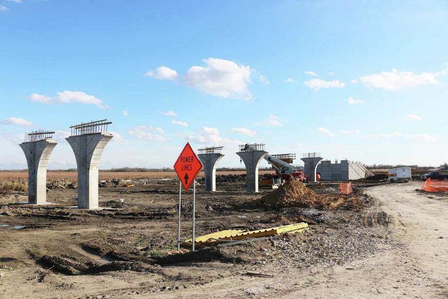 Bridge beams and ramps for the bridge over CR 1413 in Dayton are already being constructed as part of the segment of SH 99 that runs through the Dayton area. Photo: David Taylor / Staff Photo