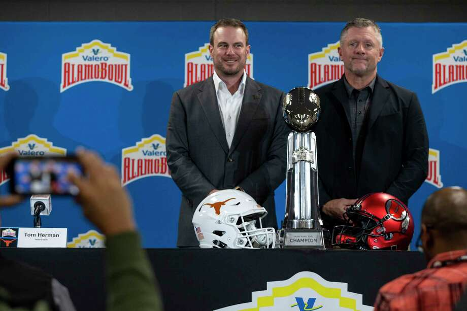 Texas Longhorns' Head Coach Tom Herman and Utah Utes' Head Coach Kyle Whittingham pose together after their final press conferences before the Valero Alamo Bowl at the Alamodome in San Antonio, Texas, Dec. 30, 2019. Photo: Josie Norris, Staff Photographer / The San Antonio Express-News / **MANDATORY CREDIT FOR PHOTOG AND SAN ANTONIO EXPRESS-NEWS/NO SALES/MAGS OUT/TV