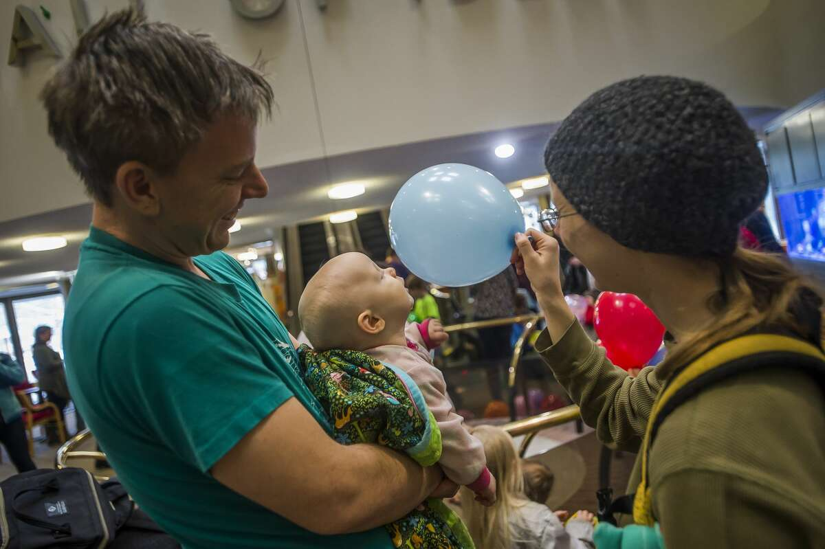 Children play with balloons during a New Year's Eve balloon drop at the Midland Center for the Arts Tuesday, Dec. 31, 2019. (Katy Kildee/kkildee@mdn.net)