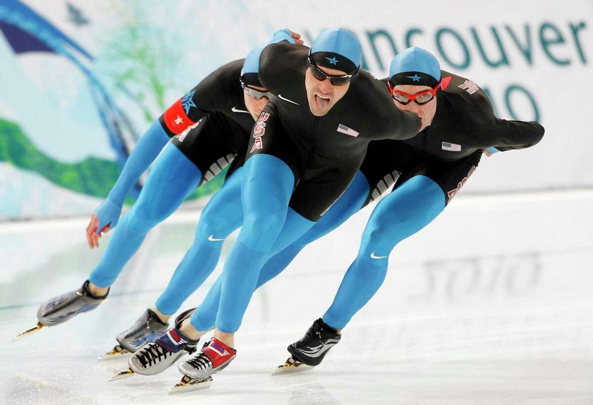 Team USA's Brian Hansen, left, Chad Hedrick, center, and Jonathan Kuck, right, skate for silver during the men's team pursuit final speed skating race at the Richmond Olympic Oval at the Vancouver 2010 Olympics in Vancouver, British Columbia, Saturday, Feb. 27, 2010. (AP Photo/Kevin Frayer)